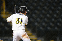 Bradenton Marauders shortstop Max Moroff (31) at bat in the pouring rain during a game against the Jupiter Hammerheads on April 17, 2014 at McKechnie Field in Bradenton, Florida.  Bradenton defeated Jupiter 2-1.  (Mike Janes/Four Seam Images)