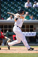 Tyler Colvin (26) of the Charlotte Knights follows through on his swing against the Indianapolis Indians at BB&T BallPark on June 21, 2015 in Charlotte, North Carolina.  The Knights defeated the Indians 13-1.  (Brian Westerholt/Four Seam Images)