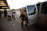 QUEENS  --  MAY 07, 2010:   People ride commuter vans on May 07, 2010 in Queens.  ..PHOTOGRAPH BY MICHAEL NAGLE.