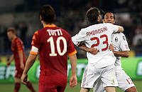 Calcio, Serie A: Roma-Milan. Roma, stadio Olimpico, 7 maggio 2011..Football, Italian serie A: AS Roma vs AC Milan. Rome, Olympic stadium, 7 may 2011..AC Milan defender Alessandro Nesta, right, and midfielder Massimo Ambrosini celebrate at the end of the match for the winning of the 18th championship as AS Roma forward Francesco Totti, left, leaves the pitch..UPDATE IMAGES PRESS/Riccardo De Luca