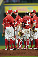 The Houston Cougars have a meeting on the mounds during the game against the Vanderbilt Commodores during game nine of the 2018 Shriners Hospitals for Children College Classic at Minute Maid Park on March 3, 2018 in Houston, Texas. The Commodores defeated the Cougars 9-4. (Brian Westerholt/Four Seam Images)
