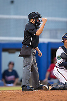 Home plate umpire Josh Gilreath makes a strike call during the Appalachian League game between the Elizabethton Twins and the Danville Braves at American Legion Post 325 Field on July 1, 2017 in Danville, Virginia.  The Twins defeated the Braves 7-4.  (Brian Westerholt/Four Seam Images)