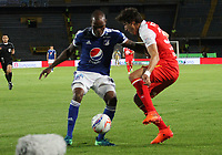 BOGOTÁ - COLOMBIA, 11-11-2018:Jair Palacios (Izq.) jugador de Millonarios disputa el balón con Facundo Guichon  (Der.) jugador del Independiente Santa Fe durante partido por la fecha 19 de la Liga Águila II 2018 jugado en el estadio Nemesio Camacho El Campín de la ciudad de Bogotá. /Jair Palacios (L) player of Millonarios  fights for the ball with Facundo Guichon (R) player of Independiente Santa Fe during the match for the date 19 of the Liga Aguila II 2018 played at the Nemesio Camacho El Campin Stadium in Bogota city. Photo: VizzorImage / Felipe Caicedo / Staff.