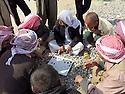 Iraq 2015 <br /> In the camp of Berseve, Yazidi men playing a game in the sun  <br /> Iraq 2015 <br /> Au camp de Berseve, hommes Yezidi jouant a un jeu dehors au soleil.