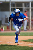 Toronto Blue Jays Tanner Kirwer (33) runs to first base during an exhibition game against the Canada Junior National Team on March 8, 2020 at Baseball City in St. Petersburg, Florida.  (Mike Janes/Four Seam Images)