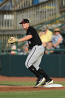 Andrew Vaughn (14) of the Kannapolis Intimidators warms up between innings of a game against the Hickory Crawdads at L.P. Frans Stadium on July 16, 2019 in Hickory, North Carolina. The Crawdads defeated the Intimidators 5-4. (Tracy Proffitt/Four Seam Images)
