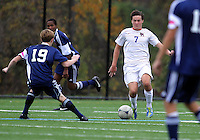 HYATTSVILLE, MD - OCTOBER 26, 2012:  Christian Cooke (7) of DeMatha Catholic High School moves in on Nate Johnson (19) of St. Albans during a match at Heurich Field in Hyattsville, MD. on October 26. DeMatha won 2-0.