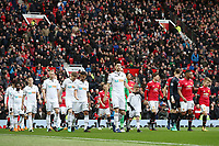 Federico Fernandez of Swansea City leads the team out on to the pitch prior to the Premier League match between Manchester United and Swansea City at the Old Trafford, Manchester, England, UK. Saturday 31 March 2018