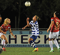 20130906 - OOSTAKKER , BELGIUM : Gent's Margaux Van Ackere pictured in a header surrounded with Kika Van Es (left) and Manon Van Den Boogaard (right) during the female soccer match between AA Gent Ladies  and PSV / FC Eindhoven Dames , of the third matchday in the BENELEAGUE competition. Friday 06 th September 2013. PHOTO DAVID CATRY