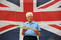 BNPS.co.uk (01202) 558833<br /> Pic: ZacharyCulpin/BNPS<br /> <br /> Pictured: Best of British - Philip Warren with his new model of HMS Glasgow which is now on display at a new exhibition at the Nothe Fort in Weymouth<br /> <br /> A master modeller who was inundated with hundreds of rare matchboxes after appealing for donations has used them to build a 3ft long aircraft carrier.<br /> <br /> Now Philip Warren has added the impressive model to his so-called matchbox fleet of miniature ships which have gone on display in an exhibition.<br /> <br /> Mr Warren's 72 year pastime of building model warships had looked as though it had come to an end earlier this year when he ran out of the traditional wooden boxes he used to make the hull and decks.<br /> <br /> But the 90-year-old was sent more than 300 of the lightweight matchboxes made from aspen wood in response to his plea for more.