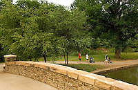 Families walk down the path at Freedom Park in the Myers Park neighborhood in Charlotte, NC. Myers Park is one of the premier neighborhoods in North America and known for its large canopy of trees.