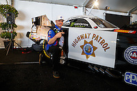 Feb 8, 2017; Pomona, CA, USA; NHRA funny car driver Robert Hight poses with California Highway Patrol themed car during media day at Auto Club Raceway at Pomona. Mandatory Credit: Mark J. Rebilas-USA TODAY Sports