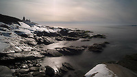 Winter leaves the Beavertail Light frozen in a silvery sunset.