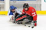Adam Dixon, Vancouver 2010 - Para Ice Hockey // Para-hockey sure glace.<br /> Team Canada plays against Italy in Para Ice Hockey action // Équipe Canada affronte l'Italie dans un match de para-hockey sur glace. 13/03/2010.