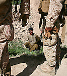 "A young Afghan farmer is held briefly for questioning by Marines from Company L, 3rd Battalion, 6th Marine Regiment, after a Taliban attack near Marjah, Afghanistan. The farmer said he saw three men running away after the attack, but the Marines decided not to go after them. ""There's really nothing to be gained by chasing three guys who may or may not be Taliban and who are 800 meters away, "" said 1st Lt. Carl Quist, 30, of Annandale, Va.  The farmer was let go, and the Marines returned to their patrol base an hour's march away. March 10, 2010. DREW BROWN/STARS AND STRIPES"