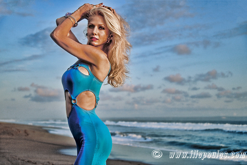 Beautiful young blond woman posing at the beach