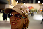 Art goer at Art Basel.....Art Basel invades Miami every year in December. This is it's fifth year in South Florida. Galleries from all around the world come to Miami to show their latest works. Over $100 million worth of art was sold during the week of December 7-10.