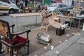 Stallholder in Golborne Road, the downmarket end of Portobello Road street market, London.