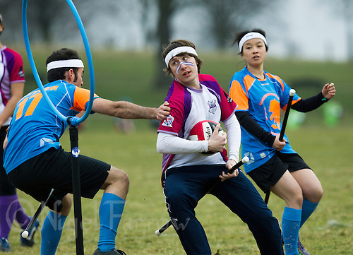 08 MAR 2015 - NOTTINGHAM, GBR - Jack Woolrich of Loughborough Longshots tries to evade a challenge from David Reutter of Cambridge University Quidditch Club during the 2015 British Quidditch Cup at Woollaton Hall and Deer Park in Nottingham, Great Britain (PHOTO COPYRIGHT © 2015 NIGEL FARROW, ALL RIGHTS RESERVED)
