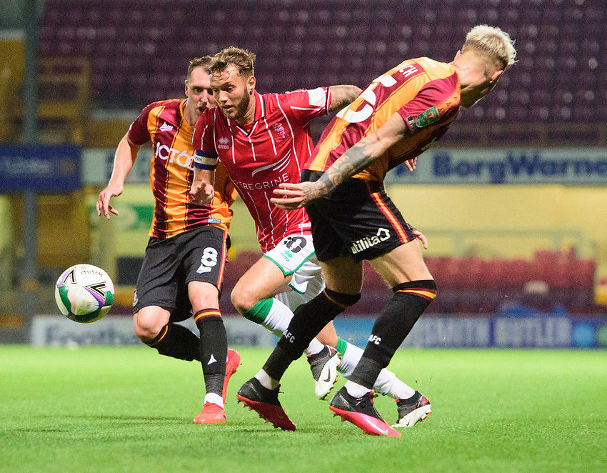 Lincoln City's Jorge Grant battles with Bradford City's Callum Cooke, left, and Tyler French<br /> <br /> Photographer Chris Vaughan/CameraSport<br /> <br /> Carabao Cup Second Round Northern Section - Bradford City v Lincoln City - Tuesday 15th September 2020 - Valley Parade - Bradford<br />  <br /> World Copyright © 2020 CameraSport. All rights reserved. 43 Linden Ave. Countesthorpe. Leicester. England. LE8 5PG - Tel: +44 (0) 116 277 4147 - admin@camerasport.com - www.camerasport.com