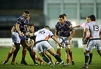 George Horne of London Scottish Football Club is tackled by Jamie Kilbane of Ealing Trailfinders during the Greene King IPA Championship match between London Scottish Football Club and Ealing Trailfinders at Richmond Athletic Ground, Richmond, United Kingdom on 26 December 2015. Photo by Alan  Stanford / PRiME Media Images
