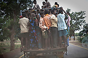 Local villagers are seen travelling on the back of a truck on the main highway in Jharkhand, India.  Photograph: Sanjit Das/Panos