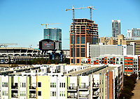 Aerial photography of the new booming expansion of apartment housing in the South End of Charlotte looking back into Uptown Charlotte, North Carolina.<br /> <br /> Charlotte Photographer - PatrickSchneiderPhoto.com