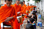 Monks make their morning alms round in Luang Prabang, Laos on Wednesday, March 5, 2008.  Luang Prabang was added to Unesco's World Heritage list in 1995.  (photo by Khampha Bouaphanh)