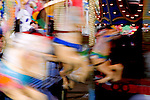 Carousel, Carnival Rides on Midway at State Fair.  Western Washington State Fair, Puyallup, Washington.