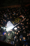 Palestinian men carry a body of a Palestinian alleged attacker upon its release by the Israeli security forces in the West Bank city of Ramallah, on December 31, 2015. Israeli authorities turned over a number of bodies to the Palestinian authorities after holding many of the bodies of attackers, a policy that has been criticised by rights groups. Photo by Shadi Hatem