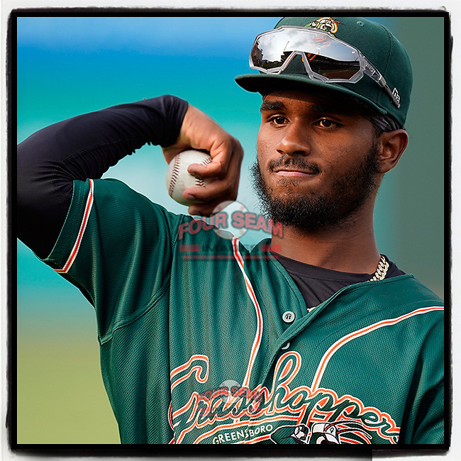 Shortstop Liover Peguero (10) of the Greensboro Grasshoppers before a game against the Greenville Drive on Thursday, July 22, 2021, at Fluor Field at the West End in Greenville, South Carolina. (Tom Priddy/Four Seam Images)