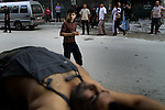 A boy walks near the body of a man that died en route to a local clinic in the heart of Aleppo city on Tuesday, October 9, 2012. ..© Javier Manzano..