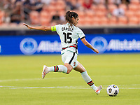 HOUSTON, TX - JUNE 13: Carole Costa #15 of Portugal crosses the ball during a game between Nigeria and Portugal at BBVA Stadium on June 13, 2021 in Houston, Texas.