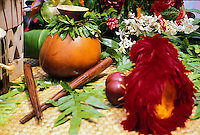 Hula implements on a float in the Aloha Festivals Parade, Honolulu.  From left to right you have Pu'ili (split bamboo rattle), an Ipu and red and yellow feather Uli Uli.