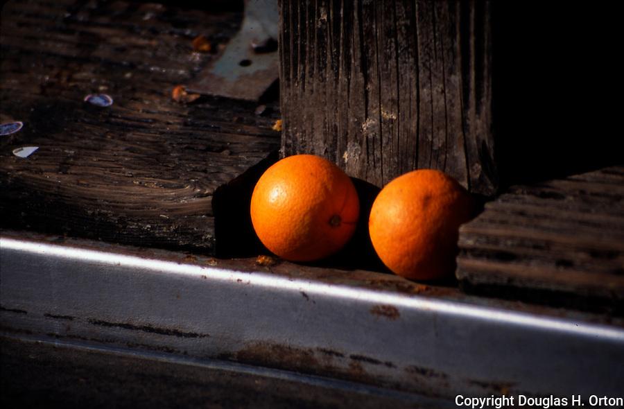 Oranges lie near bin