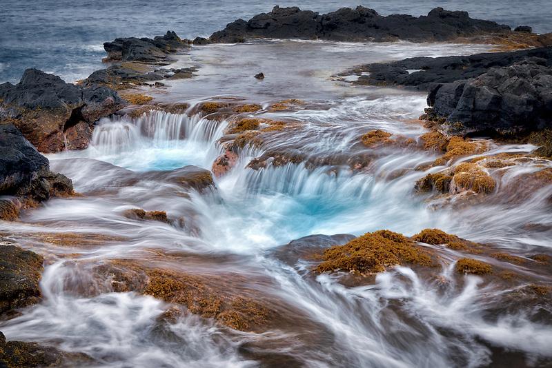 Ocean water drain well and sunset. Hawaii Island. The Big Island