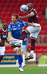 St Johnstone v Hearts...25.09.11   SPL Week 9.Mehdi Taouil outjumps Chris Millar.Picture by Graeme Hart..Copyright Perthshire Picture Agency.Tel: 01738 623350  Mobile: 07990 594431