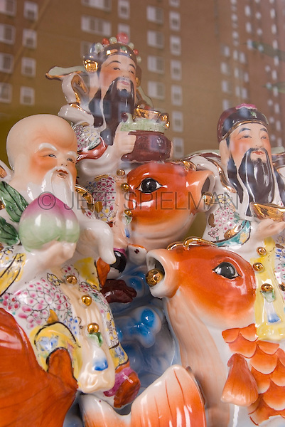 Window Refelection - Detail of a Decorative Statue Displayed in the Window of a Buddhist Temple on the Bowery in Chinatown, New York City, New York State, USA