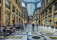 Fine Art Photograph of the Galleria Umberto I In the City of Naples. The street is covered by an arching glass and cast iron roof, a popular design for 19th-century arcades.<br /> This photograph captures the look and feel of this amazing building in the heart of Naples.