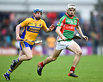 Ryan Taylor of Clooney-Quin in action against Conor Deasy of  Sixmilebridge during their senior county final replay at Cusack park. Photograph by John Kelly.