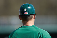 Charlotte 49ers assistant coach John Stott coaches first base during the game against the East Carolina Pirates at Hayes Stadium on March 8, 2020 in Charlotte, North Carolina. The Pirates defeated the 49ers 4-1. (Brian Westerholt/Four Seam Images)