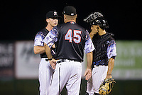 Kannapolis Intimidators pitching coach Brian Drahman (45) has a meeting on the mound with relief pitcher Ian Hamilton (12) and catcher Seby Zavala (21) during the game against the Delmarva Shorebirds at Kannapolis Intimidators Stadium on June 25, 2016 in Kannapolis, North Carolina.  The Intimidators defeated the Shorebirds 2-1.  (Brian Westerholt/Four Seam Images)