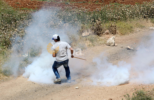 Palestinians clash with Israeli security forces during a demonstration against the establishment of Israeli outposts on their lands, in Beit Dajan, east of Nablus in the occupied West Bank, on April 30, 2021. Photo by Shadi Jarar'ah