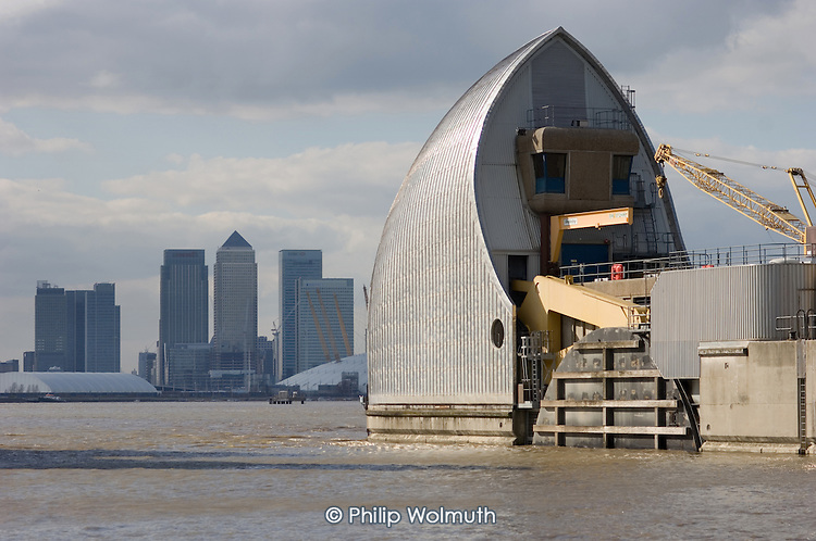 Part of the Thames Barrier, in Greenwich, and the Canary Wharf towers in London's Docklands.