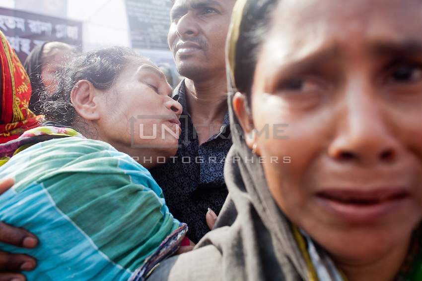 Relatives of victims with thousands of people gather at the Rana Plaza collapse site today to commemorate the tragedy that happened one year ago.