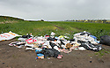 DISCARDED LITTER ON A FARM ROAD BETWEEN GRANGEMOUTH AND BO'NESS, NEAR POLMONTHILL.