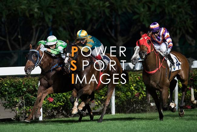 Jockey #4 Matthew Poon Ming-fai riding Crown Avenue (R) during the race 3 of Hong Kong Racing at Happy Valley Race Course on November 29, 2017 in Hong Kong, Hong Kong. Photo by Marcio Rodrigo Machado / Power Sport Images