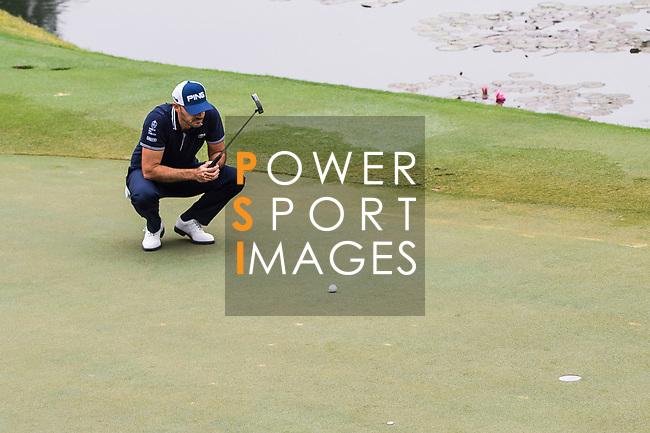 Gregory Havret of France lines up a putt during the day three of UBS Hong Kong Open 2017 at the Hong Kong Golf Club on 25 November 2017, in Hong Kong, Hong Kong. Photo by Marcio Rodrigo Machado / Power Sport Images