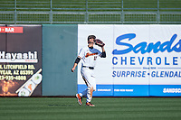 Oregon State Beavers center fielder Micah McDowell (12) catches a fly ball during an NCAA game against the New Mexico Lobos at Surprise Stadium on February 14, 2020 in Surprise, Arizona. (Zachary Lucy / Four Seam Images)