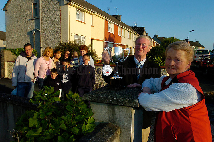 John Sullivan, president of Ennis Community Games accepts the  Christy Gormley Memorial Cup from Mrs. Patricia Gormley after it was presented by her family in honour of her late husband. Looking on are members of the family as well as Ennis Community Games secretary Geraldine Sharkey. Photograph by John Kelly.